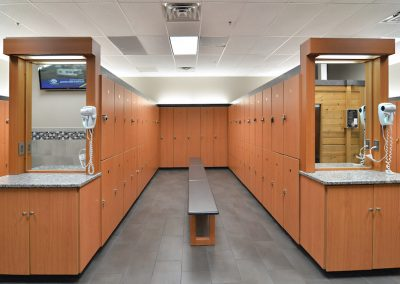 Fully equipped locker rooms with private lockers and dressing stations